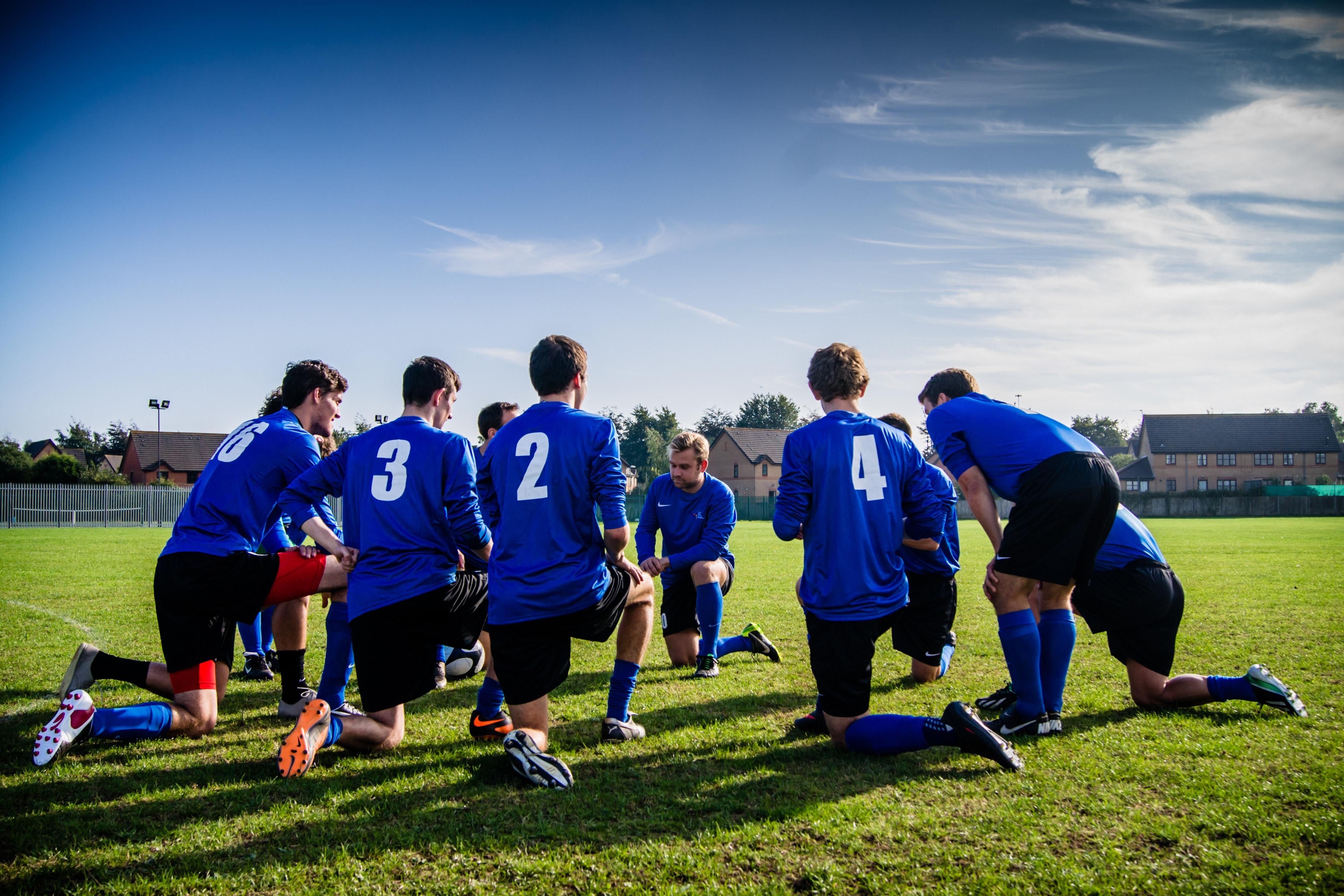 Lag som stretchar inför träning